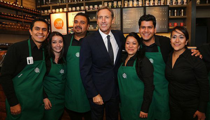 Howard Shultz with Starbucks employeess